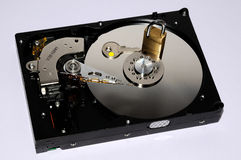 Gold padlock on the opened HDD disk drive surface. Data protection or security concept. Royalty Free Stock Photography
