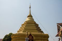 The gold pagoda in front of blue sky. stock image