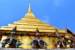 Gold pagoda. Giant Thai Style And Gold Pagoda On Blue Sky Royalty Free Stock Photos