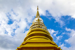 Gold pagoda pinnacle Thailand and cloudy sky background Royalty Free Stock Photography