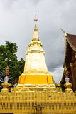 Gold pagoda with teak wood chapel, lanna style Stock Photo