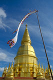 Gold pagoda in Thailand with tradition flag Stock Photography