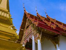 Gold pagoda and tympanum in Thailand. Thai ancient arts Stock Photo
