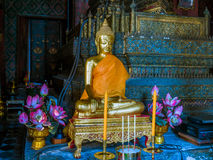 Gold pained Buddha statues with 2 candles and 2 joss stick. Thai ancient arts Stock Image