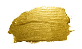 Gold paint brush stroke. Royalty Free Stock Images