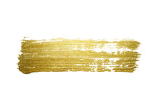 Gold paint brush stroke. Royalty Free Stock Photo