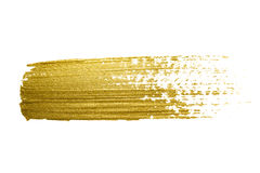 Gold paint brush stroke. Royalty Free Stock Image