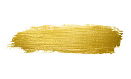 Gold paint brush stroke. Royalty Free Stock Photography