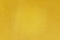 Gold paint on rough cement wall texture background. Gold paint on rough cement wall texture for background stock image