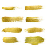 Gold paint smear stroke stain set. Stock Photos