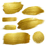 Gold paint smear stroke stain set. Stock Photo