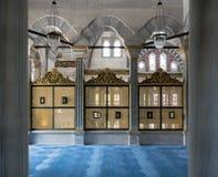 Gold painted decorated Interleaved wooden windows Mashrabiya inside three marble arches, Nuruosmaniye Mosque, Istanbul, Turkey. Three gold painted decorated Royalty Free Stock Images