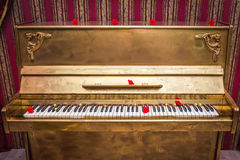 Gold painted piano royalty free stock photography