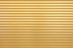 Gold Painting Shutter Door. Royalty Free Stock Photo