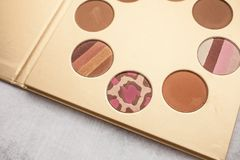 Gold palette with bronzer for makeup. beauty and fashion concept royalty free stock photography