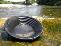 Gold pan. On a river bed in France Stock Images