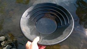Gold Panning in the river royalty free stock image