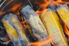 Gold  paper burning to ancestor Royalty Free Stock Images