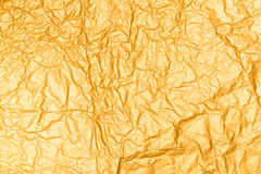 Gold Paper creased and folded Royalty Free Stock Photography