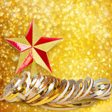 Gold paper horizontal ribbon and Christmas star Royalty Free Stock Photos