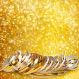 Gold paper ribbon on abstract snowy background Royalty Free Stock Photos