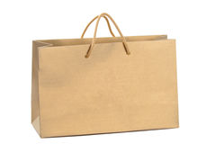 Gold paper shopping bag Royalty Free Stock Images