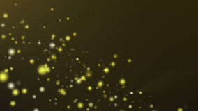 Gold particle flow on dark gold background stock footage