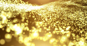 Gold particle wave with light flare. Abstract background Stock Images