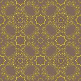 Gold pattern on a bronze background Royalty Free Stock Image