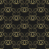 Gold pattern from curls on a black background. Royalty Free Stock Photos