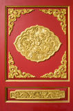 Gold Pattern temple wall. Red Background in Thailand Royalty Free Stock Photography