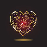 Gold patterned heart. Gold heart patterned on a dark background Royalty Free Stock Photography