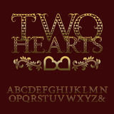 Gold patterned letters with tendrils. Vintage romantic font Royalty Free Stock Image