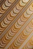 Gold patterns. Background. symmetric lines Royalty Free Stock Images