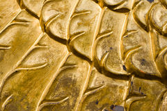 Gold patterns. Metal abstract background Royalty Free Stock Images