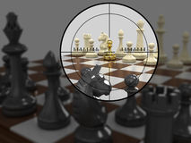 Gold pawn 2. The chessboard with figures of gold pawn in the center of the optical sight. On a gray background Stock Photo