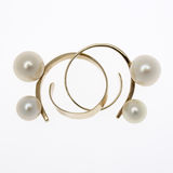 Gold and Pearl Earrings. On White Royalty Free Stock Image