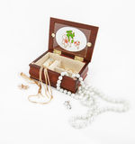 Gold and pearl jewelry, jewelery box on white background Stock Photography