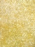 Gold pearl sequins, shiny glitter background royalty free stock image