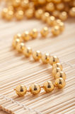 Gold pearls Royalty Free Stock Image