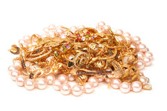 Gold and pearls jewelry. Yellow gold and pink pearl jewelry on white background Royalty Free Stock Images