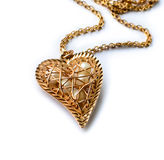 Gold pedant in a heart shape Stock Photography