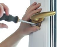 Gold pen. Fasten the window handle to the PVC window. Gold pen. Fasten the window handle to the PVC window stock video