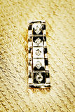 Gold pendant. Royalty Free Stock Image