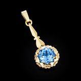 Gold pendant with blue stone Stock Photo