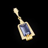 Gold pendant with blue stone Royalty Free Stock Photos