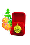 Gold pendant cameo earring jewelry with flowers isolated on whit. Gold pendant cameo earring jewellery with special Thai gold design and flowers isolated on Stock Images