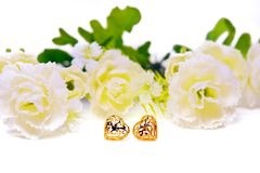Gold pendant cameo jewelry in heart shape with flowers isolated Stock Photos