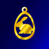 Gold pendant in the form of an Easter Bunny in egg. Gold pendant in the form of the Easter Bunny the Golden egg stock illustration