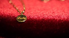 Gold pendant necklace stock video footage